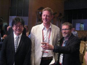 Presidents: incoming Curtis Brainard (center), outgoing Dr. Chul Joong Kim (left), past Vesa Niininkangas (right) (c) Goede